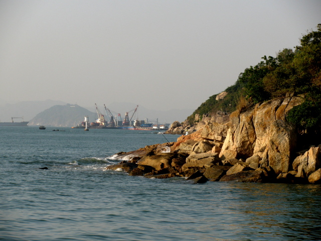 fishermen and commercial boats in the background