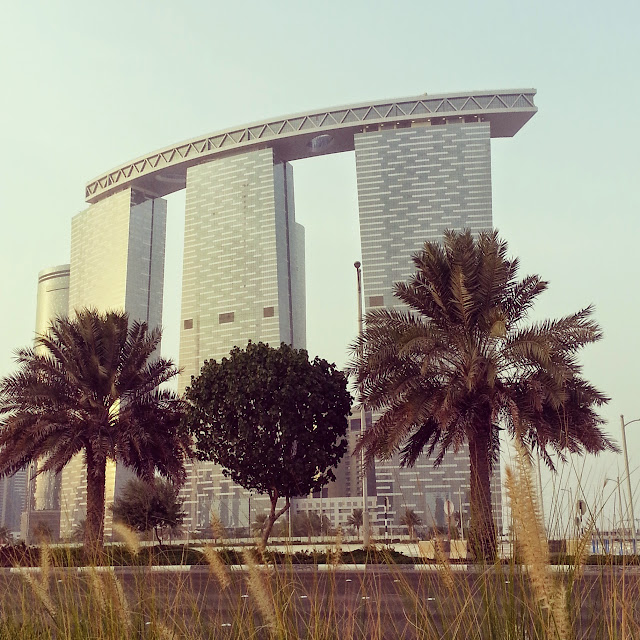 Travel Journal to Abu Dhabi UAE by ServicefromHeart Gate Towers like Marina Bay Sands