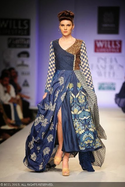 A model showcases a creation by fashion designers Ashish Viral and Vikrant on Day 5 of Wills Lifestyle India Fashion Week (WIFW) Spring/Summer 2014, held in Delhi.