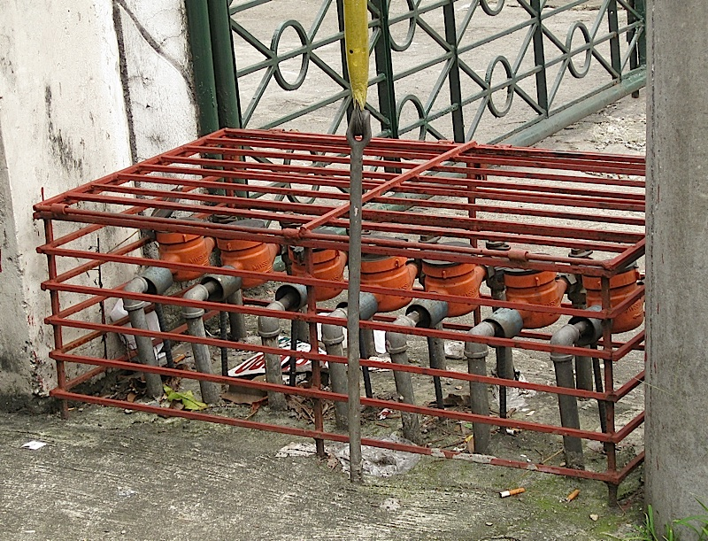 row of water meters in a metal cage