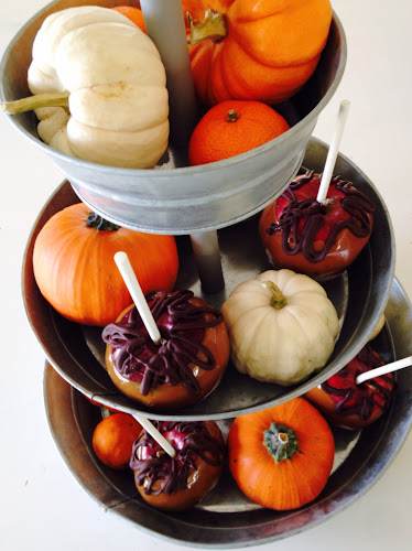 Caramel apples and pumpkins