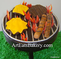 Unique cookout fondant hot dogs and hamburger grill cake on butter cream grass closeup
