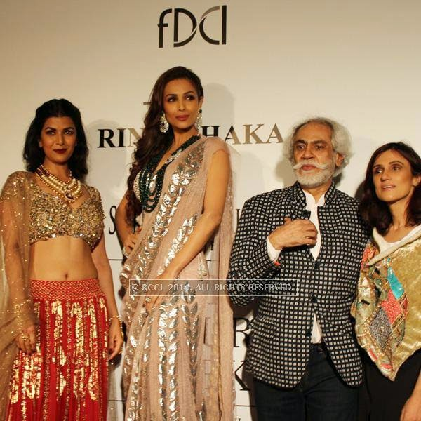 Nimrat Kaur, Malaika Arora Khan, Sunil Sethi and Rina Dhaka during the India Couture Week, 2014, held at Taj Palace, in New Delhi.