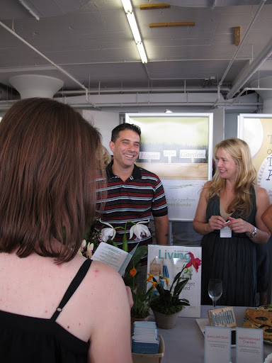 Tom from Garden and Charlotte from the Food Department chatting with guests.