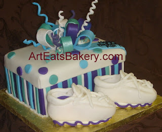 Custom designed fondant sneakers and purple, green and blue shoe box present birthday cake with bow