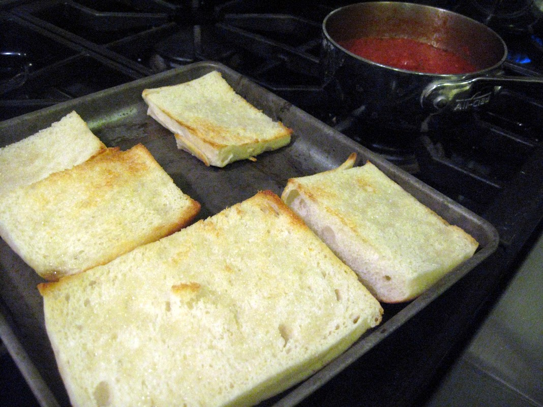 Toasting the bread before adding the toppings.