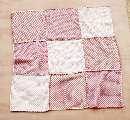 Loom woven pretty pink baby throw.