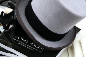 Top hat and magazine at Royal Ascot