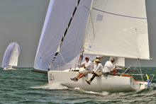 J/80 one-design sailboat- planing along under spinnaker