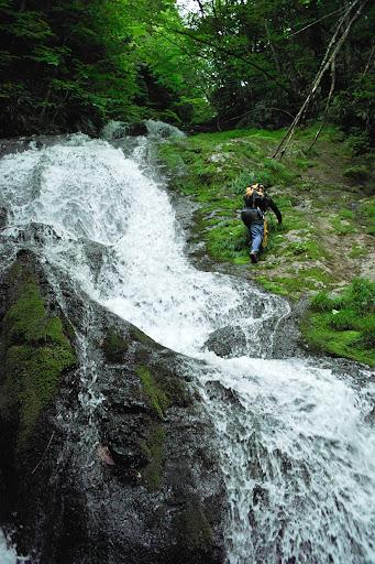 Climbing waterfall fishing
