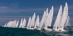 J/70 one-design sailboats- sailing off start- Key West Race Week