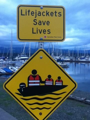 """Lifejackets save lives"" sign at Comox Marina"