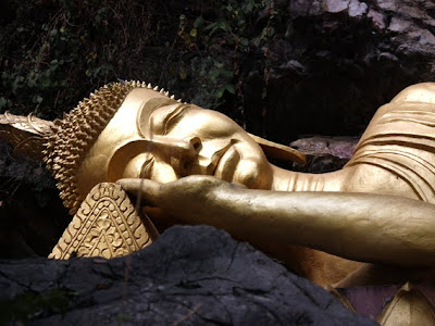 Golden reclining Buddha statue on Mount Phou Si in Luang Prabang Laos