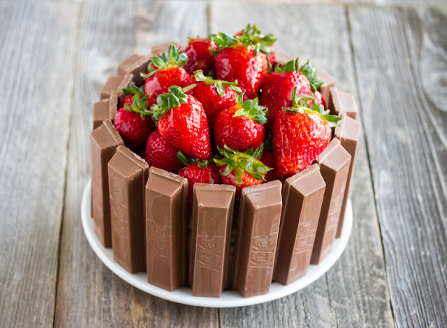 photo of a Kit Kat Cake topped with fresh strawberries