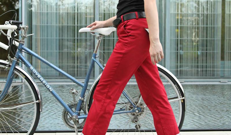 Red BTW Ellie hand on seat walking bike