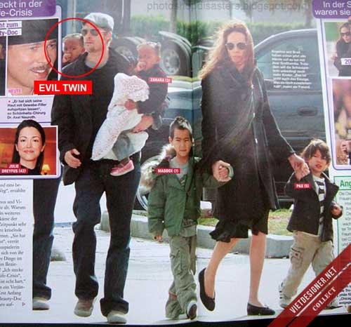 Bản sao gương mặt bé gái mà Brad Pit đang bế xuất hiện sau lưng nam diễn viên này.