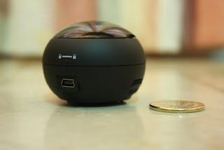 X-mini v1.1 beside a 5-peso coin