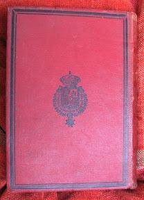 Contratapa con escudo real español.