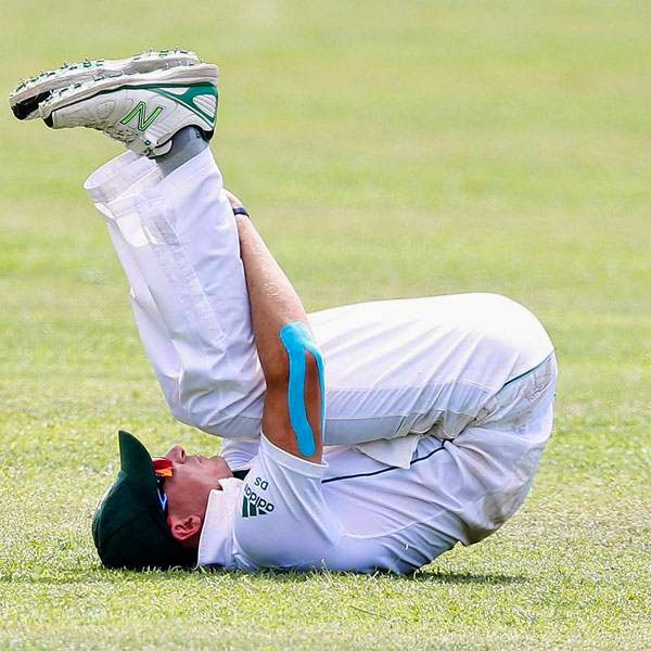 South Africa's Dale Steyn stretches during the first day of their second test cricket match against Sri Lanka in Colombo July 24, 2014.