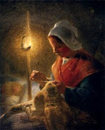 Modista cosiendo a la luz de la vela