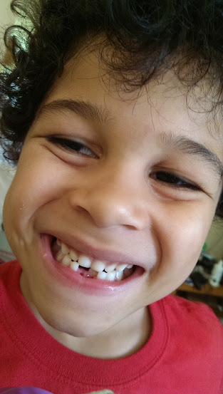 My gap-toothed, curly-headed boy.