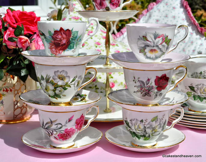 pink and green eclectic vintage teacups set stacked