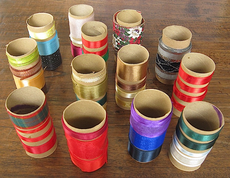 used ribbons rolled around cardboard toilet paper cores