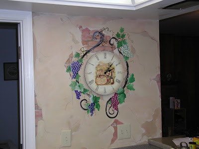 Tuscan style painted wall with grapes on wrought iron to surround client's existing clock.