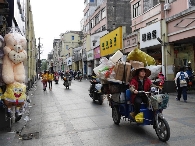 woman driving a motorized tricycle cart in Yangjiang, China
