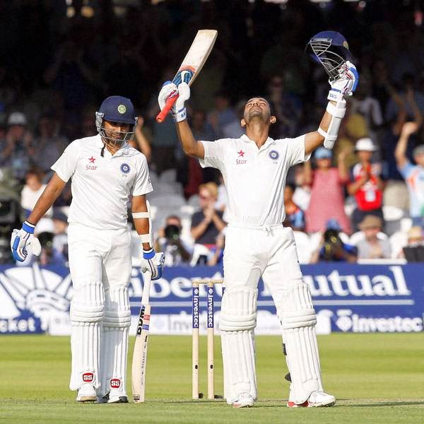 India's Ajinkya Rahane (R) celebrates after reaching a century not out during play on the first day of the second cricket Test match between England and India at Lord's cricket ground in London on July 17, 2014.