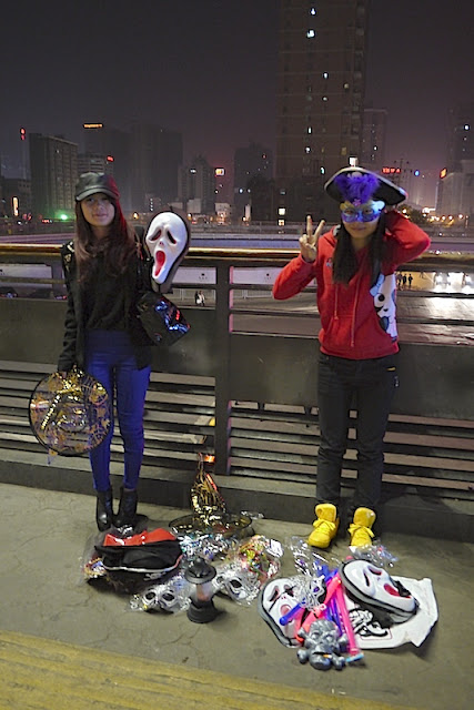 two young women selling Halloween items in Changsha, China