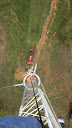 Andy K1RA looking down microwave tower
