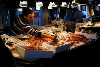 A vendor at the Fish Markets - Venice, Italy