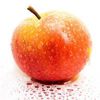 red apple covered in dew