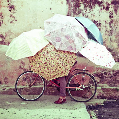 girl umbrellas bike