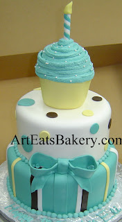 Three tier blue, brown, white and yellow custom boys 1st birthday cake with stripes, polka dots, and cupcake topper