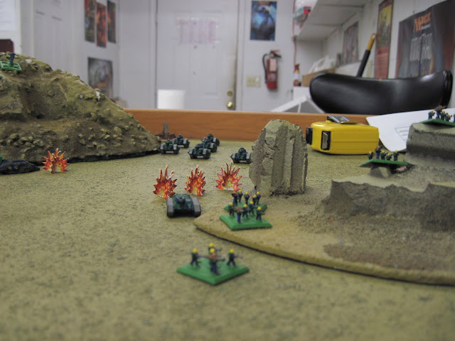 The Skitarii take fire as the Russes advance.