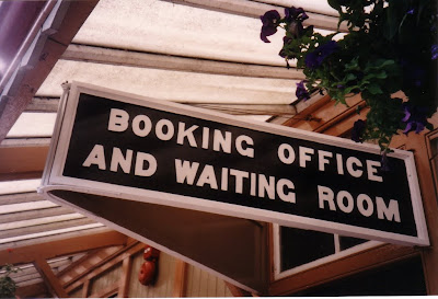 A freshly painted sign, flower baskets and an alarm bell!  Autumn 1997.  Photo:  ?