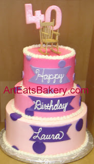 Three tier pink and purple butter cream and fondant custom 40th birthday cake with rocking chair topper