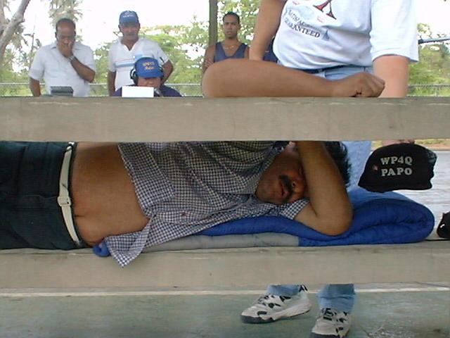 Papo, WP4Q, takes a break at Field Day, June                   26-27, 1999. (photo courtesy of Rafael Bonano, KP4RV)