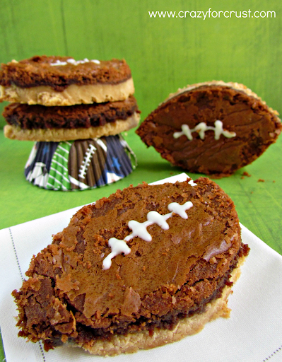 Nutella brownie footballs with peanut butter shortbread crust on a green background