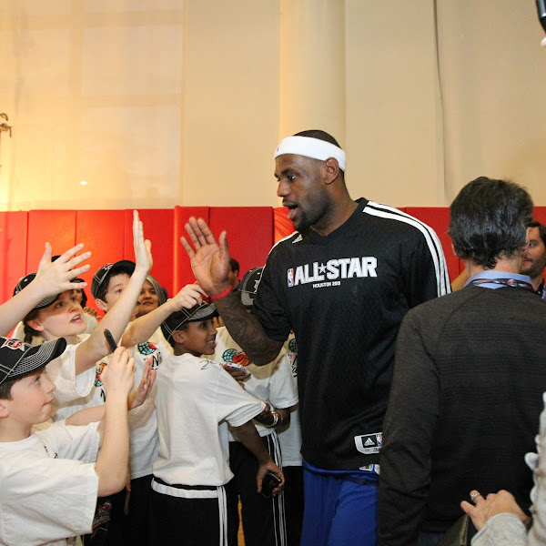 LeBron James #6 of the Eastern Conference All-Stars high fives fans before the 2013 NBA All-Star Game on February 17, 2013 at Toyota Center in Houston, Texas.