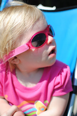 girl wearing pink Baby Banz sunglasses