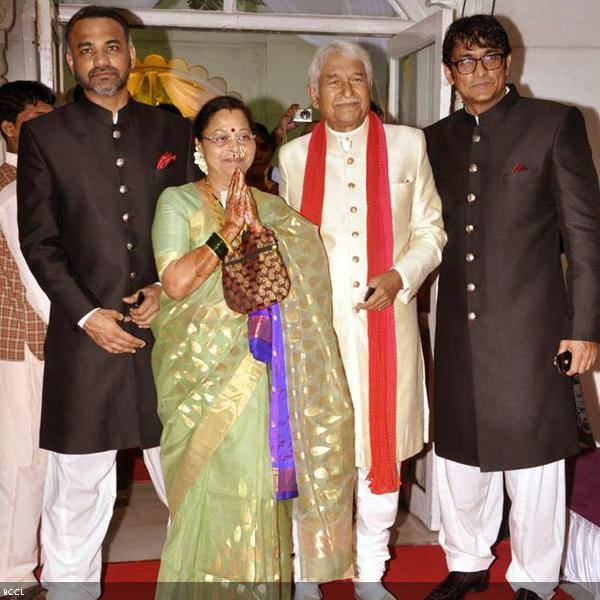 Seema and Ramesh Deo greet the media with sons Abhinay (L) and Ajinkya Deo at their 50th wedding anniversary, held at ISKCON, in Mumbai, on July 1, 2013. (Pic: Viral Bhayani)