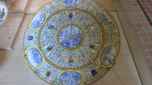 Maiolica plate with scenes from the life of Joan of Arc