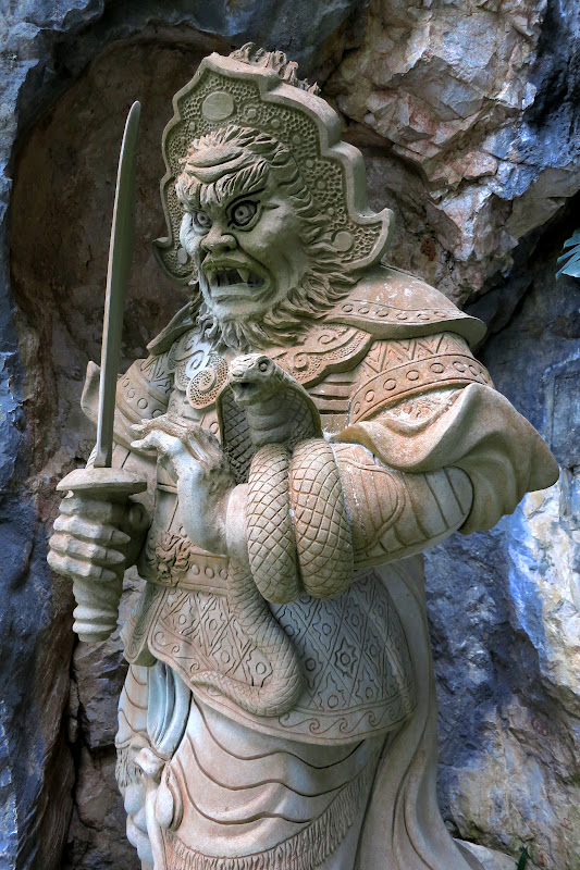 Guardian at entrance to Am Phu Cave