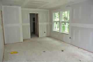 Picture of the master bedroom as viewed from the walk in closet with drywall installed
