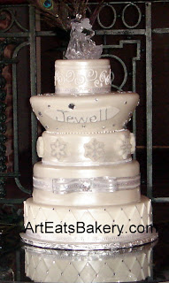 Five tier custom designed silver pearl wedding cake with snowflakes, rhinestones, ribbons and curlicues