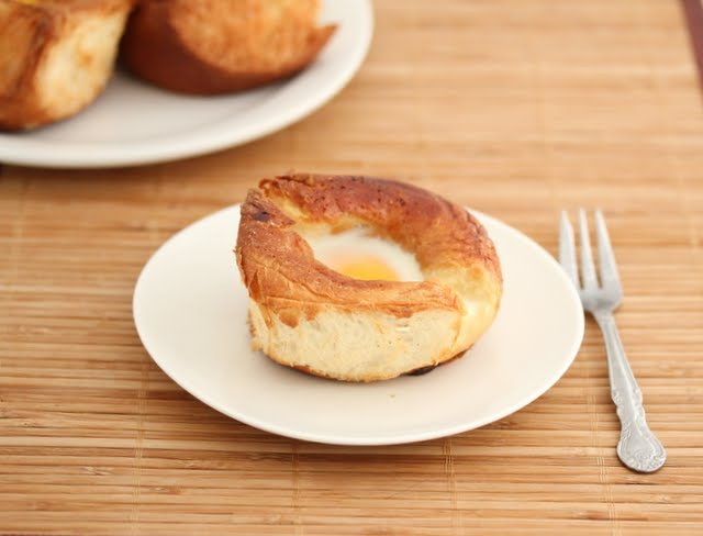 photo of an egg in a roll on a plate