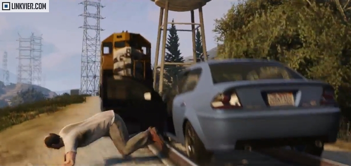 Trevor Jumping out of a moving car about to crash into a train.